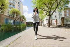 Full length of fit young woman jogging Royalty Free Stock Photos