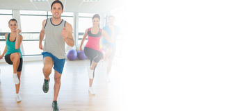 Full length of fitness class and instructor doing pilates exercise Stock Photography