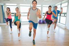 Full length of fitness class and instructor doing pilates exercise Stock Images