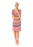 Full length of flirtatious woman in summer dress isolated on whi Stock Photo