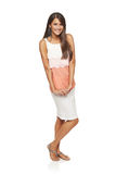Full length flirty elegant woman in dress Stock Photography