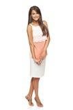 Full length flirty elegant woman in dress Stock Images