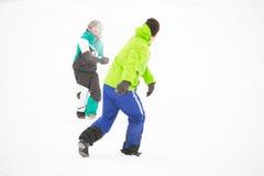 Full length of friends having snowball fight Stock Image