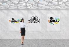 Full length girl in a formal clothes is pointing out the whiteboard with possible paths of further education. The concept Royalty Free Stock Photos