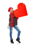 Full length girl holding up a red cardboard heart Stock Image