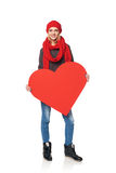 Full length girl holding up a red cardboard heart Stock Photography