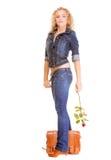 Full length girl in jeans bag holds red rose Royalty Free Stock Image