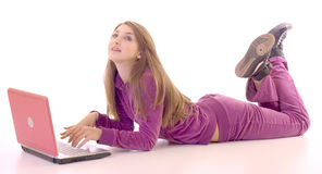 Full length of a girl lying on floor using laptop Royalty Free Stock Photography
