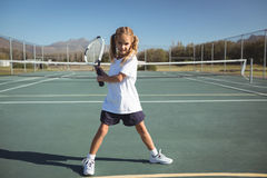 Full length of girl playing tennis Stock Photo
