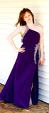 Full length girl in prom dress. Teen girl wearing purple evening gown Royalty Free Stock Photography