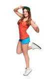 Full length girl showing thumb up sign. Portrait of happy teen funky girl in full length showing thumb up sign, over white background Stock Images