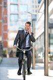 Full length of handsome men go to on work with bike Stock Photos