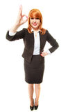Full length happy businesswoman. Redhaired girl showing ok sign Royalty Free Stock Image