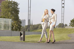 Full length of happy businesswomen walking together on street Royalty Free Stock Image