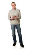 Full length happy mature man using digital tablet Stock Image