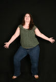 Full length of happy overweight woman stock image