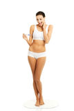 Full length happy woman holding pregnancy test Royalty Free Stock Photo