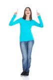 Full length happy woman pointing up Royalty Free Stock Photography