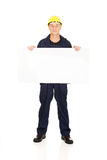 Full length happy worker presenting empty banner.  Stock Images