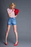 Full length of happy young blond fashion model  in striped top, Stock Photos
