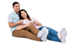 Full length happy young couple with cup Royalty Free Stock Photos
