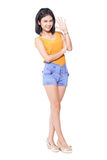 Full length of a happy young woman smiling Royalty Free Stock Photography