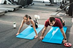 Fitness Couple Doing Push Ups Together stock photos