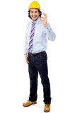 Full length image of engineer with ok sign Royalty Free Stock Photography