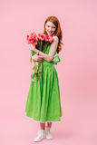 Full length image  ginger woman holding bouquet of flowers Royalty Free Stock Photos