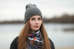 Full length lifestyle portrait of young and pretty adult woman with gorgeous long hair posing in city park with shallow depth of f. Full length lifestyle stock image