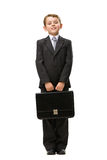 Full length of little businessman with case Stock Image