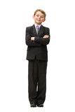 Full length of little businessman with crossed arms. Full-length portrait of little businessman with his arms crossed, isolated on white. Concept of leadership royalty free stock image