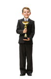 Full length of little businessman with gold cup Royalty Free Stock Photos