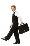 Full-length of little businessman walking with case Stock Photo