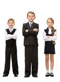 Full length of little children with hands crossed. Full-length portrait of little children with hands crossed, isolated. Concept of teamwork and cooperation stock photography