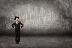 Full length of little student against modern city drawing Stock Photos
