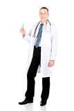 Full length male doctor holding a syringe Royalty Free Stock Photography