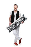 Full length of male musician with synthesizer. Royalty Free Stock Images