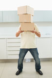 Full length of man carrying boxes in front of his face stock photography