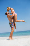 Full length of man carrying girlfriend Stock Photography