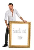 Full length of man holding a blank banner in old frame Stock Photos