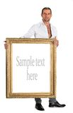 Full length of man holding a blank banner in old frame Stock Photo