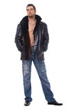 Full Length Of A Man In Leather Jacket. Full length portrait of a handsome man holding hands in his pockets over white Royalty Free Stock Image