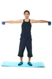 Full length of man lifting barbell Royalty Free Stock Photos