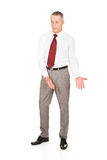 Full length man showing copyspace on the floor Stock Photography