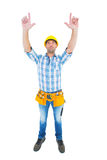 Full length of manual worker forming hand frame Royalty Free Stock Photos