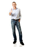 Full length mature man gesturing ok sign.  Royalty Free Stock Images
