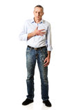 Full length mature man with heart disease Stock Photo