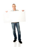 Full length mature man holding empty banner Stock Images