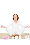 Full length of mature woman meditating Stock Photography